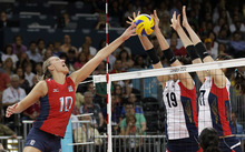 USA's Jordan Larson (10) pushes the ball at South Korea's Kim Hee-jin (19) and Yang Hyo-jin during a women's volleyball semifinal match at the 2012 Summer Olympics Thursday, Aug. 9, 2012, in London. (AP Photo/Chris O'Meara)