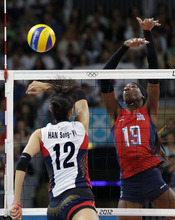 USA's Destinee Hooker (19) blocks a smash by South Korea's Han Song-yi (12) during a women's volleyball semifinal match at the 2012 Summer Olympics Thursday, Aug. 9, 2012, in London. (AP Photo/Chris O'Meara)