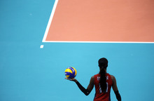 United States' Destinee Hooker prepares to serve during a women's semifinal volleyball match against South Korea at the 2012 Summer Olympics, Thursday, Aug. 9, 2012, in London. (AP Photo/Jeff Roberson)