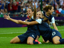 USA's Carli Lloyd (10) celebrates her first goal with Kelley O'Hara (5) and Alex Morgan (13) in the first half of their game against Japan for the Women's Football Gold Medal Match at Wembley Stadium for the London 2012 Olympics in London, England on Thursday, Aug. 9, 2012.  (Nhat V. Meyer/Mercury News)