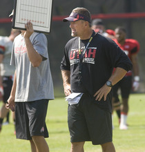 Paul Fraughton | Salt Lake Tribune Coach Kyle Whittingham watches his team scrimege at Tuesday's practice.  Tuesday, August 7, 2012