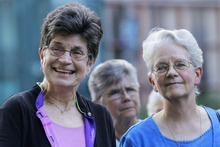 In this Aug. 9, 2012 photo, out going President of The Leadership Conference of Women Religious Sister Pat Farrell, left, and president elect Sister Florence Deacon, right, participates in a vigil with supporters in St. Louis. The largest U.S. group for Roman Catholic nuns meet to decide how they should respond to a Vatican rebuke and order for reform. The LCWR, represents most of the 57,000 American nuns. (AP Photo/Seth Perlman)