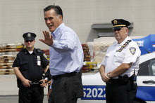 Republican presidential candidate, former Massachusetts Gov. Mitt Romney steps off his charter plane Wednesday as he arrives at a campaign stop in Newark, N.J. In addition to his own stops, he's sending campaign surrogates around the country. Utah Rep. Jason Chaffetz is one of the busiest. (AP Photo/Charles Dharapak)
