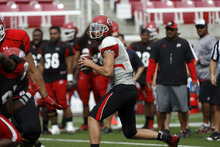 Francisco Kjolseth     The Salt Lake Tribune Quarterback Travis Wilson looks for an open man before deciding to run the ball down field as the University of Utah football team gets ready for the season with a scrimmage game at Rice-Eccles stadium on Friday, August 10, 2012.