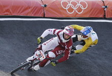 Latvia's Maris Strombergs  competes in the BMX cycling men's final run at the 2012 Summer Olympics, Friday, Aug. 10, 2012, in London. Strombergs won his second straight Olympic gold medal in BMX on Friday, taking the lead out of the starting gate and never relinquishing it. (AP Photo/Sergey Ponomarev)