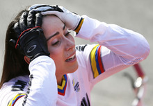 Colombia's Mariana Pajon reacts after winning the women's BMX cycling competition during the 2012 Summer Olympics, Friday, Aug. 10, 2012, in London. Pajon, a former world champion, has won the women's BMX competition at the London Olympics, giving Colombia its first gold of the games.(AP Photo/Matt Rourke)