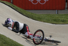 United States' Alise Post crashes during a BMX cycling women's semifinal run during the 2012 Summer Olympics in London, Friday, Aug. 10, 2012. (AP Photo/Christophe Ena)