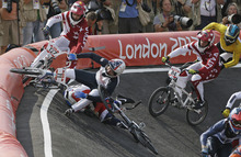 Latvia's Edzus Treimanis (127) and Latvia's Rihards Veide (84) avoid a crash by United States' Connor Fields (11) in a BMX cycling men's semifinal run during the 2012 Summer Olympics, Friday, Aug. 10, 2012, in London. (AP Photo/Matt Rourke)