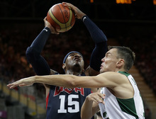 USA's Carmelo Anthony is defended by Lithuania's Sarunas Jasikevicius, right, during a preliminary men's basketball game at the 2012 Summer Olympics, Saturday, Aug. 4, 2012, in London. (AP Photo/Eric Gay)