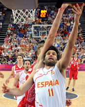 Spain's guard Fernando San Emeterio, front, is challenged by Russia's forward Andrei Kirilenko during a men's semifinal basketball game at the 2012 Summer Olympics on Friday, Aug. 10, 2012, in London. (AP Photo/Mark Ralston, Pool)