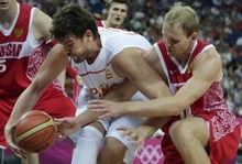 Spain's Marc Gasol, left, battles Russia's Anton Ponkrashov for the ball during a men's semifinals basketball game at the 2012 Summer Olympics, Friday, Aug. 10, 2012, in London. (AP Photo/Charles Krupa)