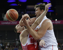 Russia's Vitaliy Fridzon (7) is defended by Spain's Marc Gasol, right, as he tries to shoot during a semifinal men's basketball game at the 2012 Summer Olympics, Friday, Aug. 10, 2012, in London. (AP Photo/Eric Gay)