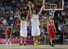 Spain's Pau Gasol (4) and teammate Felipe Reyes (9) celebrate their win over Russia in a semifinal men's basketball game at the 2012 Summer Olympics, Friday, Aug. 10, 2012, in London. Russia's Andrei Kirilenko is at left and Vitaliy Fridzon is at right.(AP Photo/Eric Gay)