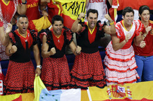 Fans dressed as flamenco dancers celebrate after Spain defeated Russian in a men's basketball semifinal game at the 2012 Summer Olympics, Friday, Aug. 10, 2012, in London. (AP Photo/Victor R. Caivano)