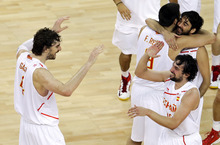 Spain's Pau Gasol, left, reacts with teammateSergio Llull, right, after Spain defeated Russian in a men's basketball semifinal game at the 2012 Summer Olympics, Friday, Aug. 10, 2012, in London. (AP Photo/Victor R. Caivano)
