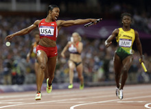 United States' Carmelita Jeter reacts as she crosses the finish line to win the women's 4 x 100-meter relay during the athletics in the Olympic Stadium at the 2012 Summer Olympics, London, Friday, Aug. 10, 2012. The United States relay team set a new world record with a time of 40.82 seconds.(AP Photo/Anja Niedringhaus)