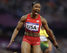 United States' Carmelita Jeter reacts after crossing the finish line to win the women's 4 x 100-meter relay during the athletics in the Olympic Stadium at the 2012 Summer Olympics, London, Friday, Aug. 10, 2012. The United States relay team set a new world record with a time of 40.82 seconds.(AP Photo/Anja Niedringhaus)