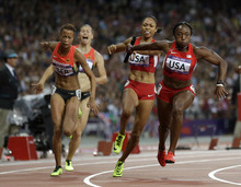 United States' Allyson Felix, second from right, passes to United States' Bianca Knight, right, in the women's 4x100-meter final during the athletics in the Olympic Stadium at the 2012 Summer Olympics, London, Friday, Aug. 10, 2012. The United States relay team set a new world record with a time of 40.82 seconds. (AP Photo/Hassan Ammar)