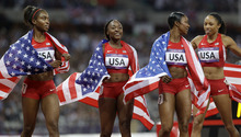 United States' women's 4 x100-meter relay team members, from left, Tianna Madison, Bianca Knight, Carmelita Jeter and Allyson Felix, celebrate their gold medal win during the athletics in the Olympic Stadium at the 2012 Summer Olympics, London, Friday, Aug. 10, 2012. The United States relay team set a new world record with a time of 40.82 seconds.(AP Photo/Lee Jin-man)