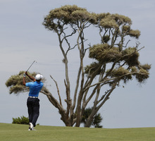 Tiger Woods watches his fairway shot on the fourth hole during the second round of the PGA Championship golf tournament on the Ocean Course of the Kiawah Island Golf Resort in Kiawah Island, S.C., Friday, Aug. 10, 2012. (AP Photo/Lynne Sladky)