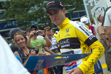 Chris Detrick  |  The Salt Lake Tribune Christian Vande Velde, of team Garmin-Sharp-Barracuda, signs autographs after winning the yellow jersey after the 136-mile Stage 4 Tour of Utah at EnergySolutions Arena Friday August 10, 2012.