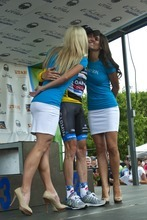 Chris Detrick  |  The Salt Lake Tribune Christian Vande Velde, of team Garmin-Sharp-Barracuda, gets kisses from Melissa Glover and Missy Jones after winning the yellow jersey after the 136-mile Stage 4 Tour of Utah at EnergySolutions Arena Friday August 10, 2012.