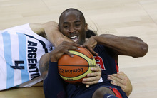 United States' Kobe Bryant, right, and Argentina's Luis Scola (4) scramble for a loose ball during a men's basketball semifinal game at the 2012 Summer Olympics, Friday, Aug. 10, 2012, in London. U.S. plays for gold on Sunday. (AP Photo/Victor R. Caivano)