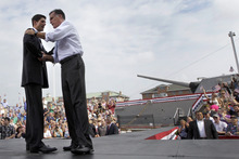 Republican presidential candidate, former Massachusetts Gov. Mitt Romney, right, joins vice presidential running mate Wisconsin Rep. Paul Ryan on stage during the Norfolk Victory campaign event, Saturday, Aug. 11, 2012, in Norfolk, Va. (AP Photo/Mary Altaffer)