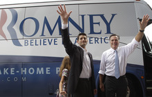Republican presidential candidate, former Massachusetts Gov. Mitt Romney, right, and vice presidential candidate Wisconsin Rep. Paul Ryan are joined by Ryan's daughter Liza as they wave to the crowd Saturday, Aug. 11, 2012, in Norfolk, Va.  (AP Photo/Mary Altaffer)