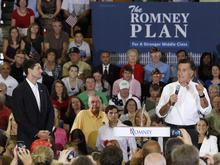 Republican Presidential candidate, Mitt Romney, right, speaks as his running mate, Rep. Paul Ryan, R-Wis. listens during a rally at Randolph-Macon College in Ashland, Va., Saturday, Aug. 11, 2012.  ( AP Photo/Steve Helber)