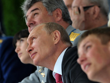 Russian President Vladimir Putin, center, and Commander-in-Chief of the Russian Air Force Viktor Bondarev, top, watch as they attend the Russian air force's 100th anniversary in Zhukovsky, outside Moscow, Russia, on Saturday, Aug. 11, 2012. (AP Photo/RIA-Novosti,  Alexei Nikolsky, Presidential Press Service)