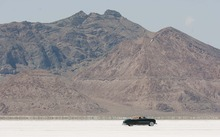 Trent Nelson  |  The Salt Lake Tribune A vintage car cruises on the salt flats at the 64th annual Speed Week at the Bonneville Salt Flats, Utah Saturday, August 11, 2012.