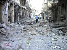 This image made from amateur video released by the Shaam News Network and accessed Saturday Aug. 11, 2012, purports to show the destruction of houses by shelling from Syrian government forces in Damascus, Syria, Wednesday, Aug. 8, 2012. (AP Photo/Shaam News Network, SSN) THE ASSOCIATED PRESS IS UNABLE TO INDEPENDENTLY VERIFY THE AUTHENTICITY, CONTENT, LOCATION OR DATE OF THIS HANDOUT PHOTO