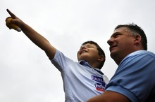 Lieutenant Commander Mike Salka and his son Gabriel Salka, 5, were part of a crowd gathered at Nauticus in Norfolk, Va., where Republican presidential candidate, former Massachusetts Gov. Mitt Romney will name his vice presidential running mate on Saturday, Aug. 11, 2012.  Romney introduced Rep. Paul Ryan of Wisconsin as his Republican vice presidential running mate on Saturday, turning to the architect of a deeply conservative and intensely controversial long-term budget plan that would remake Medicare and cut trillions in federal spending. (AP Photo/Virginian-Pilot, Amanda Lucier) MAGS OUT