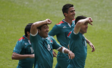 Mexico's Javier Aquino (11), Marco Fabian (8), Darvin Chavez (5) and Oribe Peralta (9) celebrate during the men's soccer final against Brazil at the 2012 Summer Olympics, Saturday, Aug. 11, 2012, in London. (AP Photo/Andrew Medichini)