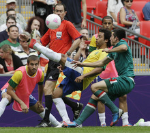 Brazil's Marcelo, left, and Mexico's Hector Herrera battle for possession during the men's soccer final at the 2012 Summer Olympics, Saturday, Aug. 11, 2012, in London. (AP Photo/Hassan Ammar)