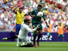 Brazil's Rafael Cabral, left, collides with Mexico's Marco Fabian during the men's soccer final at the 2012 Summer Olympics, Saturday, Aug. 11, 2012, in London. (AP Photo/Hassan Ammar)