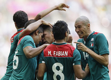 Mexico's Marco Fabian (8) celebrates with teammates after winning the gold medal in the men's soccer final against Brazil at the 2012 Summer Olympics, Saturday, Aug. 11, 2012, in London. (AP Photo/Jon Super)