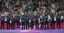 United States' thanks the crowd after winning the gold medal against France in the women's gold medal basketball game at the 2012 Summer Olympics, Saturday, Aug. 11, 2012, in London. (AP Photo/Charles Krupa)
