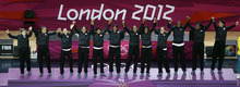 Gold medalist team of the United States waves on the podium of the women's basketball event at the 2012 Summer Olympics, Saturday, Aug. 11, 2012, in London. (AP Photo/Victor R. Caivano)