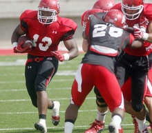 Steve Griffin | The Salt Lake Tribune   Utah running back Kelvin York breaks to the outside during a scrimmage Aug. 9, 2012.