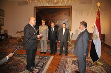 Egyptian President Mohammed Morsi swears in a newly-appointed vice president, former senior judge, Mahmoud Mekki, in Cairo, Egypt Sunday, Aug. 12, 2012. Egypt's Islamist president also ordered his defense minister and chief of staff to retire on Sunday and canceled the military-declared constitutional amendments that gave top generals wide powers. (AP Photo/Egyptian Presidency)