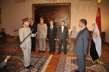 Egyptian President Mohammed Morsi, left, swears in newly-appointed Minister of Defense,  Lt. Gen. Abdel-Fattah el-Sissi, in Cairo, Egypt, Sunday, Aug. 12, 2012. Egypt's Islamist president ordered his former defense minister and chief of staff to retire on Sunday and canceled the military-declared constitutional amendments that gave top generals wide powers. (AP Photo/Egyptian Presidency)