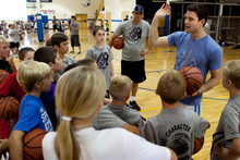 Jimmer Fredette, right, speaks to a group of participants during the Jimmer Jam Camp in Lehi, Utah, Wednesday, Aug. 8, 2012. (AP Photo/Daily Herald, Mark Johnston)