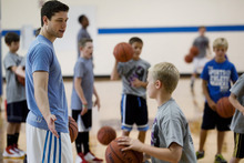 Jimmer Fredette greets participants during basketball drills at the Jimmer Jam Camp on Wednesday, Aug. 8, 2012, in Lehi, Utah. (AP Photo/Daily Herald, Mark Johnston)
