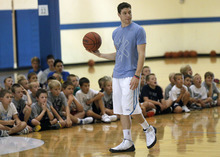 Al Hartmann  |  The Salt Lake Tribune   Jimmer Fredette runs his basketball camp Wednesday August 8 for hundreds of youngsters at the XSI Factory in Lehi.