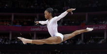 U.S. gymnast Gabrielle Douglas performs on the balance beam during the artistic gymnastics women's apparatus finals at the 2012 Summer Olympics, Tuesday, Aug. 7, 2012, in London. (AP Photo/Julie Jacobson)