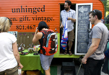 Kim Raff | The Salt Lake Tribune People shop at the Unhinged booth at the 4th annual Craft Lake City Utah's DIY Festival at the Gallivan Center in Salt Lake City, Utah on August 11, 2012.