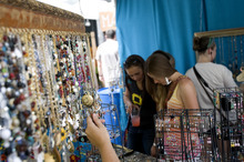 Kim Raff | The Salt Lake Tribune People look at jewelry in April Wearable Art's booth during the 4th annual Craft Lake City Utah's DIY Festival at the Gallivan Center in Salt Lake City, Utah on August 11, 2012.