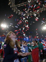 British swimmer Hannah Miley throws confetti up in the air during the Closing Ceremony at the 2012 Summer Olympics, Monday, Aug. 13, 2012, in London. (AP Photo/Jae C. Hong)